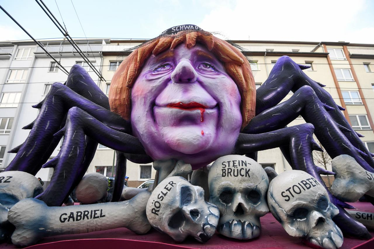 <p>A carnival float depicting German chancellor Angela Merkel as a black widow sitting over the bones and sculls of German politicians is pictured during a carnival parade on Rose Monday on Feb. 12, 2018 in Duesseldorf, western Germany. (Photo: Patrik Stollarz/Getty Images) </p>