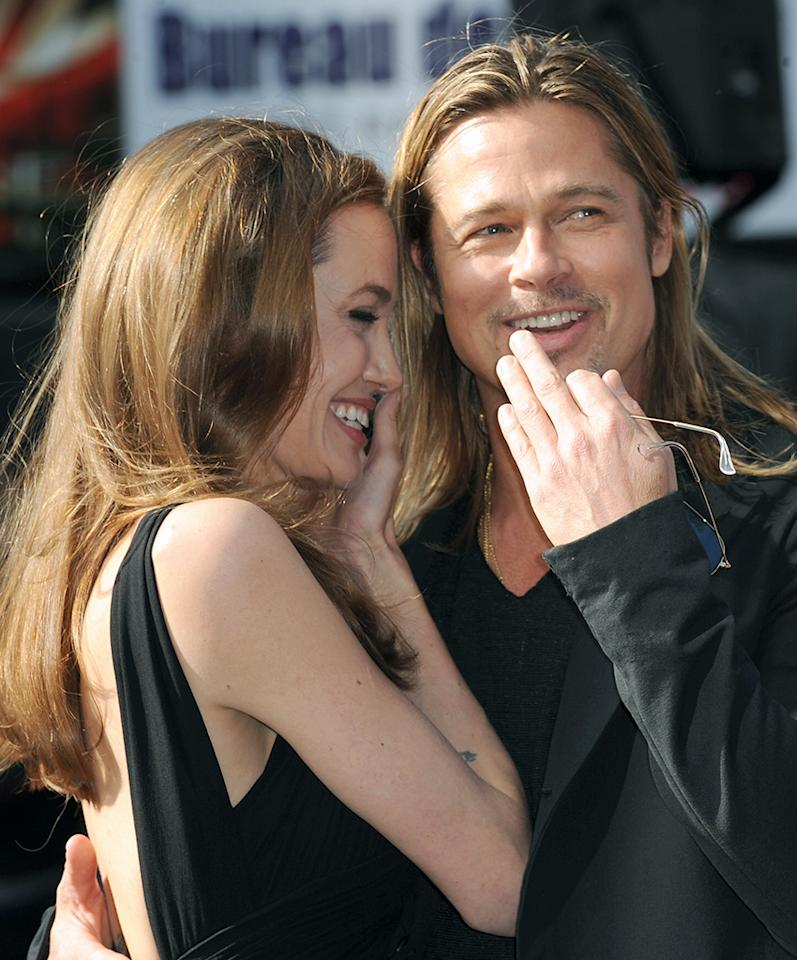 """Another happy couple was snapped canoodling in London over the weekend. Angelina Jolie and Brad Pitt hit the world Premiere of """"World War Z"""" there on Sunday, marking Jolie's first red carpet appearance since announcing she'd undergone a preventative double mastectomy. (6/2/2013)"""