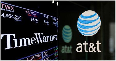 FILE PHOTO: A combination photo shows the Time Warner shares price at the New York Stock Exchange and AT&T logo in New York, NY, U.S., on November 15, 2017 and on October 23, 2016 respectively.  REUTERS/Lucas Jackson (L) and REUTERS/Stephanie Keith/File Photos