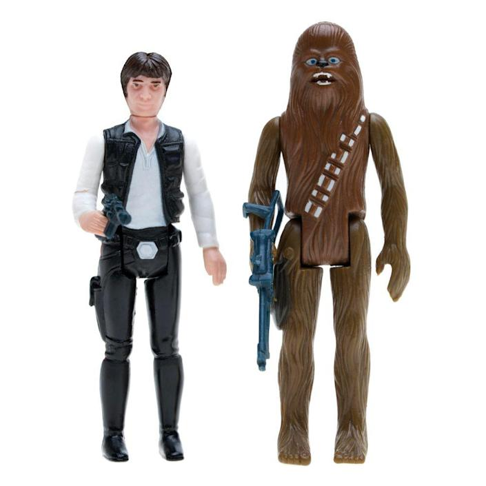 """<p><a class=""""link rapid-noclick-resp"""" href=""""https://www.amazon.com/Star-Wars-Galactic-Heroes-Rivals/dp/B01BMW5QCQ/ref=sr_1_21?tag=syn-yahoo-20&ascsubtag=%5Bartid%7C10063.g.34738490%5Bsrc%7Cyahoo-us"""" rel=""""nofollow noopener"""" target=""""_blank"""" data-ylk=""""slk:BUY NOW"""">BUY NOW</a></p><p>When George Lucas' <em>Star Wars</em> hit theaters in 1977, merchandisers were unprepared for the fandom that was about to take the world by storm. </p><p>American toy company Kenner Products quickly rushed to make a line of Star Wars miniature action figures, which consisted of Luke Skywalker, Princess Leia, Chewbacca, and R2-D2. Stores couldn't keep them on the shelves. Other characters from the movie were later made into toys, but the initial four were the most successful.</p>"""