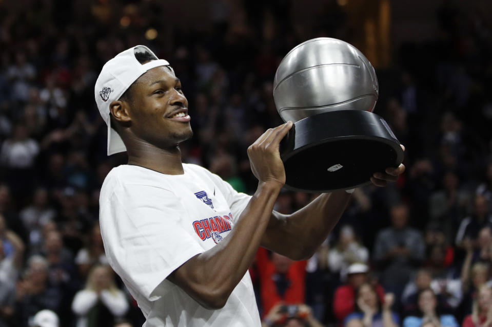 Gonzaga's Joel Ayayi (11) holds up the most outstanding player award after defeating Saint Mary's in an NCAA college basketball game in the final of the West Coast Conference men's tournament Tuesday, March 10, 2020, in Las Vegas. (AP Photo/John Locher)