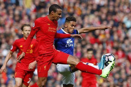 Britain Soccer Football - Liverpool v Everton - Premier League - Anfield - 1/4/17 Liverpool's Joel Matip in action with Everton's Dominic Calvert-Lewin Reuters / Phil Noble Livepic