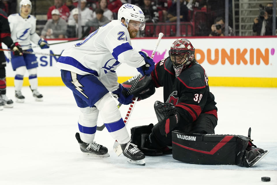 Tampa Bay Lightning center Blake Coleman (20) tries to score against Carolina Hurricanes goaltender Alex Nedeljkovic (39) during the third period in Game 1 of an NHL hockey Stanley Cup second-round playoff series in Raleigh, N.C., Sunday, May 30, 2021. (AP Photo/Gerry Broome)