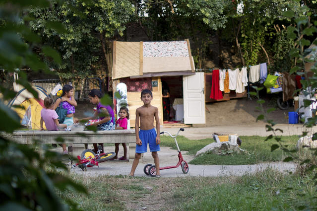 "Children from Romania families play in front of makeshift shelters housing their families in a camp near the Garonne river in Toulouse, September 11, 2012. Around 130 Roma, referred to as ""Gens du Voyage"", live in this illegal camp, a low-lying area liable to flooding, without electricity and running water. Picture taken September 11, 2012 . REUTERS/Bruno Martin (FRANCE - Tags: SOCIETY IMMIGRATION) ATTENTION EDITORS FRENCH LAW REQUIRES THAT FACES OF MINORS ARE MASKED IN PUBLICATIONS IN FRANCE"