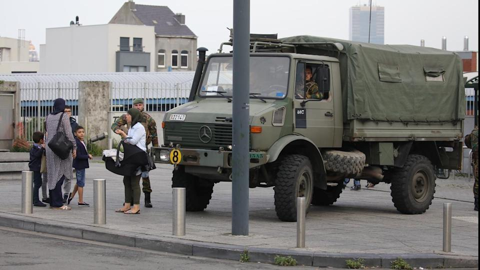 Armed forces on patrol in Molenbeek where a bomb squad was called in following a police pursuit.