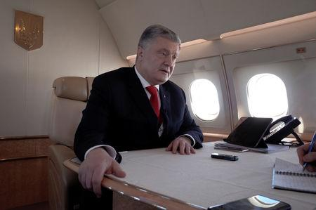 Ukraine's President Petro Poroshenko speaks during an interview with Reuters on board his plane on the way from Berlin to Paris at an unknown location in France, April 12, 2019. REUTERS/Sergiy Karazy