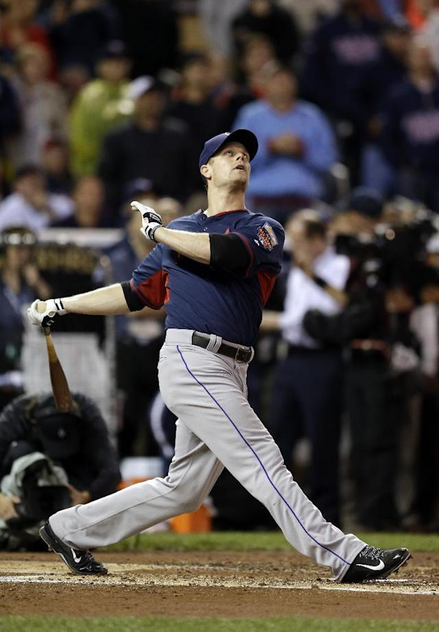 National League's Justin Morneau, of the Colorado Rockies, hits during the MLB All-Star baseball Home Run Derby, Monday, July 14, 2014, in Minneapolis. (AP Photo/Jeff Roberson)