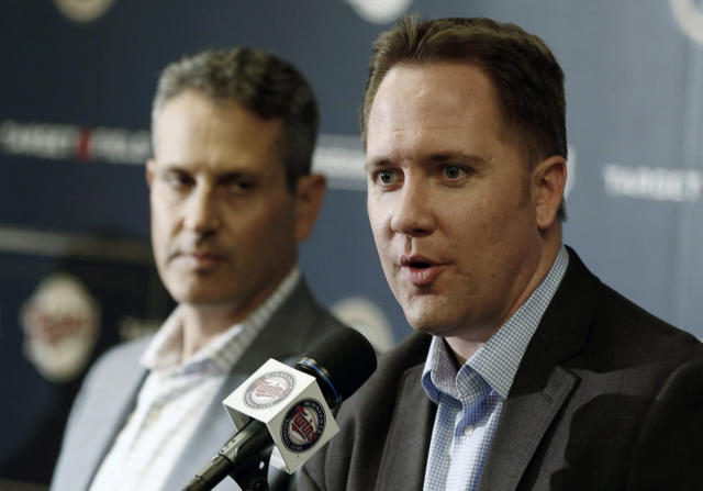 Minnesota Twins chief baseball officer Derek Falvey, right, addresses a news conference Tuesday, Oct.2, 2018 in Minneapolis she he announced that Minnesota Twins manager Paul Molitor was fired, one season after he won the American League Manager of the Year award. In four seasons under Molitor, the Twins went 305-343 with one appearance in the playoffs in 2017. They were 78-84 this year, long out of postseason contention after a series of early setbacks to several key players. Listening at left is general manager Thad Levine. (AP Photo/Jim Mone)