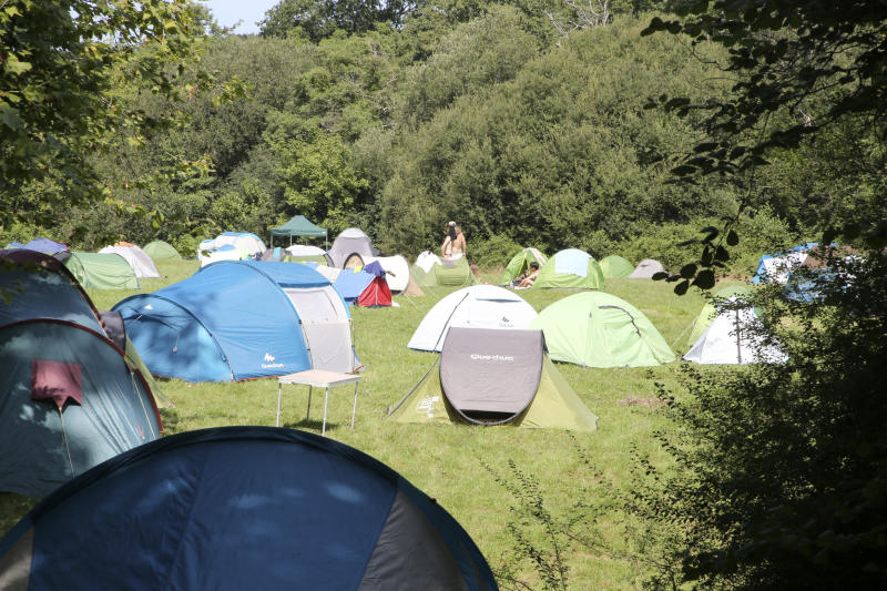 Activists set up tents in a camping site Wednesday, Aug. 21, 2019 in Urrugne, southwestern France. Protesters are setting up camp in towns near the Spanish border to prepare actions during the Aug. 24-26 gathering of major world democracies. (AP Photo/Bob Edme)