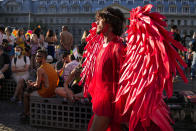 A person wears a red outfit during the Bucharest Pride 2021 in Bucharest, Romania, Saturday, Aug. 14, 2021. The 20th anniversary of the abolishment of Article 200, which authorized prison sentences of up to five years for same-sex relations, was one cause for celebration during the gay pride parade and festival held in Romania's capital this month. People danced, waved rainbow flags and watched performances at Bucharest Pride 2021, an event that would have been unimaginable a generation earlier. (AP Photo/Vadim Ghirda)