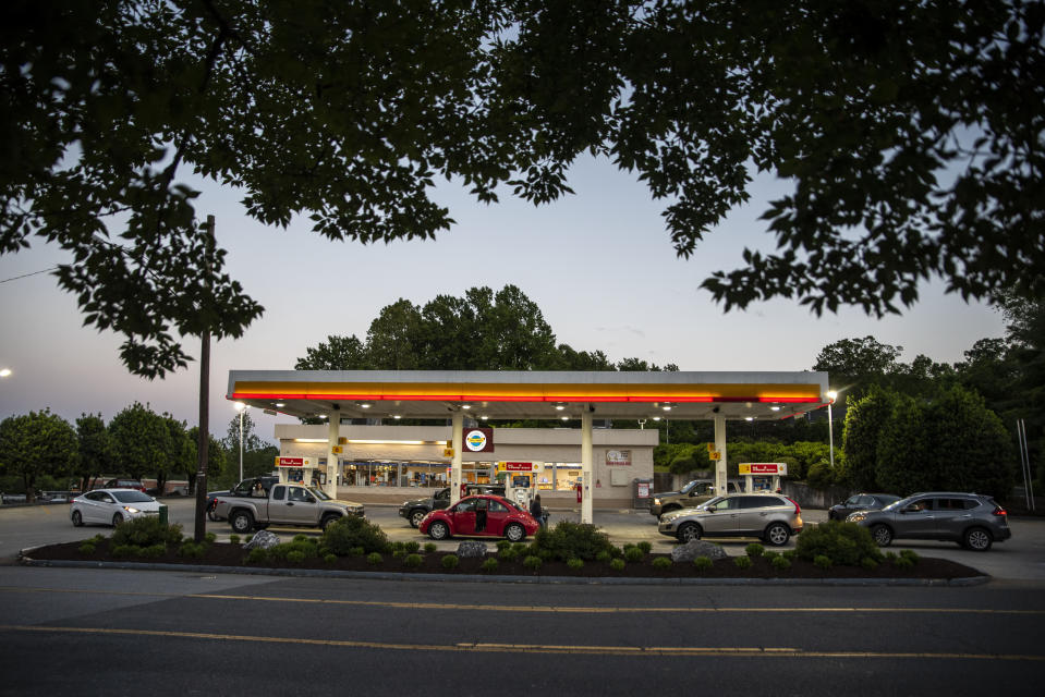Drivers line up for fuel at a Shell Gas Station attached to Moore's Country Store on Boonsboro Road in Lynchburg, Va., Tuesday, May 11, 2021. More than 1,000 gas stations in the Southeast reported running out of fuel, primarily because of what analysts say is unwarranted panic-buying among drivers, as the shutdown of a major pipeline by hackers entered its fifth day. In response, Virginia Gov. Ralph Northam declared a state of emergency. (Kendall Warner/The News & Advance via AP)