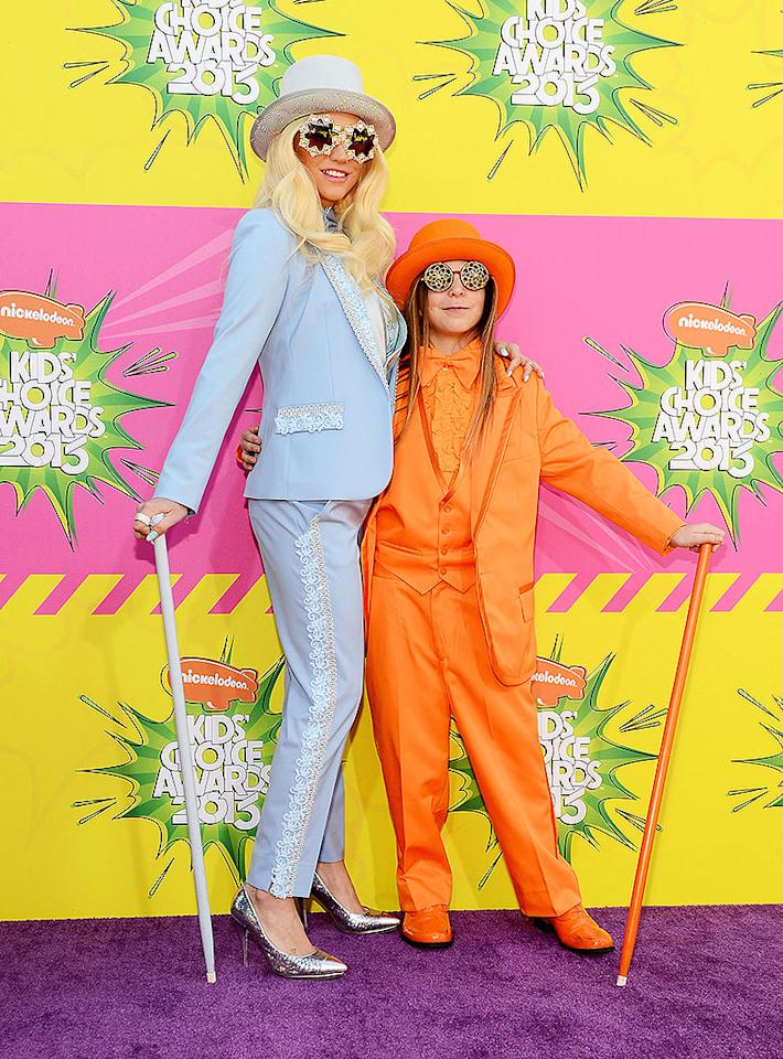 "Looks like Ke$ha's rubbing off on her 13-year-old brother Louie Sebert, who joined her on the purple carpet in an orange tux, hat, and cane. The siblings must be fans of the 1994 comedy ""Dumb & Dumber"" starring Jim Carrey and Jeff Daniels, where the two main characters sported similar looks."
