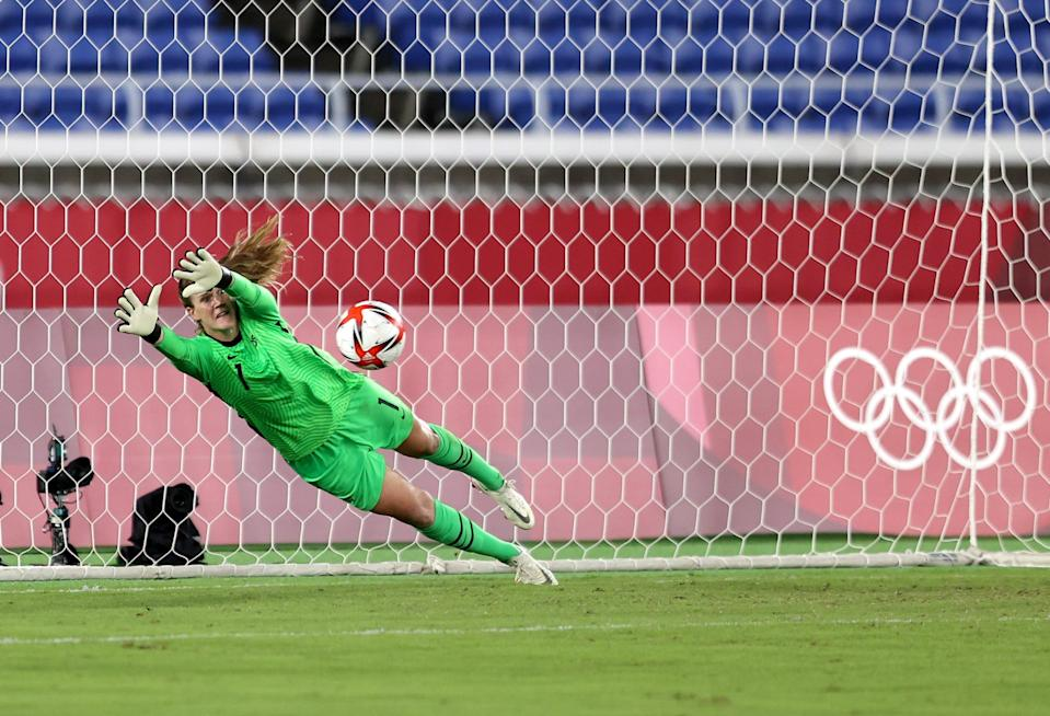 U.S. goalkeeper Alyssa Naeher saves the first penalty from Vivianne Miedema of Netherlands (not pictured) during their quarterfinal match at the Tokyo Olympics.