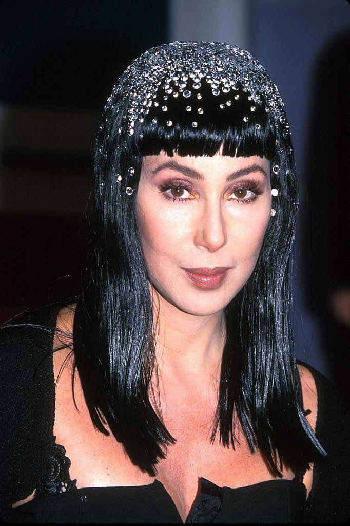 """<p>Cher, in 1990, confronted talk about her shifting appearance. """"There have been rumors, over the years — though she denies all but breast, teeth, and nose work — that she has had her buttocks lifted, two ribs removed to shrink her waist, her chin restructured, her cheeks reconstructed, her eyes lifted, her belly button reshaped, her lips collagen'd, and the planes of her face smoothed to windless surfaces,"""" noted a <a href=""""http://www.vanityfair.com/news/1990/11/cher-199011"""" rel=""""nofollow noopener"""" target=""""_blank"""" data-ylk=""""slk:Vanity Fair"""" class=""""link rapid-noclick-resp"""">Vanity Fair</a> article that year. <i>(Photo: Getty Images)</i></p>"""