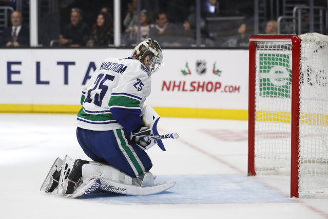 Vancouver Canucks goaltender Jacob Markstrom, of Sweden, reacts after allowing a goal to Los Angeles Kings' Matt Luff during the second period of an NHL hockey game Saturday, Nov. 24, 2018, in Los Angeles. (AP Photo/Jae C. Hong)