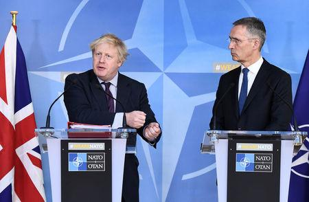 British Foreign Secretary Boris Johnson and NATO Secretary-General Jens Stoltenberg hold a joint news conference after their meeting at the Alliance headquarters in Brussels, Belgium, March 19, 2018.  REUTERS/Stringer
