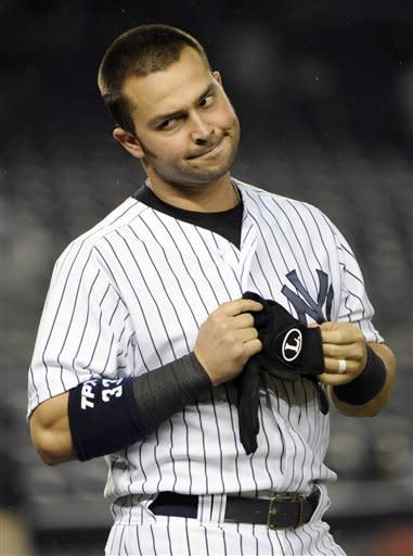 New York Yankees' Nick Swisher reacts after striking out to end the eighth inning of a baseball game against the Kansas City Royals at Yankee Stadium, Monday, May 21, 2012, in New York. The Royals won 6-0. (AP Photo/Bill Kostroun)
