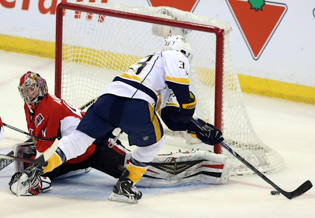 Ottawa Senators goaltender Craig Anderson (41) looks back as Nashville Predators' Colin Wilson (33) tries a backhand shot during the first period of an NHL game action, Monday, March 10, 2014, in Ottawa. (AP Photo/The Canadian Press, Fred Chartrand)