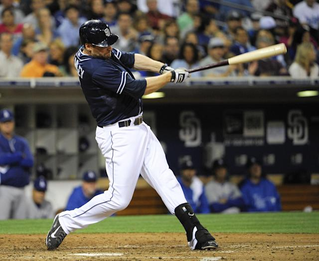SAN DIEGO, CA - SEPTEMBER 21: Chase Headley #7 of the San Diego Padres hits a double during the sixth inning of a baseball game against the Los Angeles Dodgers at Petco Park on September 21, 2013 in San Diego, California. (Photo by Denis Poroy/Getty Images)