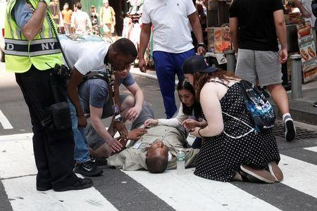 ATTENTION - VISUALS COVERAGE OF SCENES OF INJURY An injured man is seen on the sidewalk in Times Square after a speeding vehicle struck pedestrians on the sidewalk in New York City, U.S., May 18, 2017. REUTERS/Mike Segar