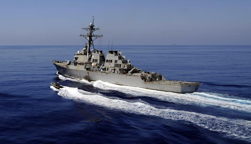 China strongly dissatisfied by USA  warships entering South China Sea