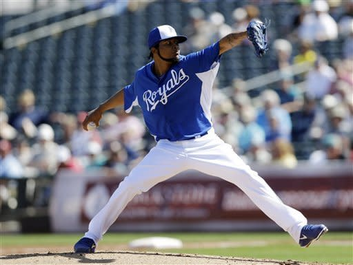 Kansas City Royals starting pitcher Ervin Santana throws to the Seattle Mariners during the second inning of an exhibition spring training baseball game on Thursday, March 7, 2013, in Surprise, Ariz. (AP Photo/Marcio Jose Sanchez)