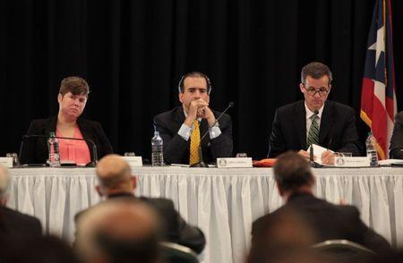 Chairman of Puerto Rico's fiscal control board Jose Carrion III (2nd L), members of the board Ana Matosantos (L) and David Skeel attend a meeting of the Financial Oversight and Management Board for Puerto Rico at the Convention Center in San Juan, Puerto Rico March 31, 2017. Picture taken March 31, 2017. REUTERS/Alvin Baez