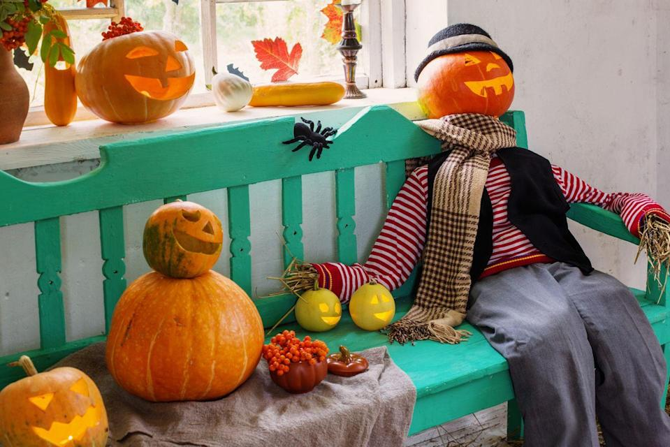 <p>Gather the family and create a scarecrow to sit on your front porch. You can make the face using a jack-o'-lantern, and get creative building the rest. If you don't have hay to fill your scarecrow, use crumpled newspaper instead. </p>