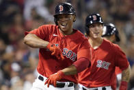Boston Red Sox's Rafael Devers celebrates his two-run home run against the New York Yankees during the fifth inning of a baseball game at Fenway Park, Friday, July 23, 2021, in Boston. (AP Photo/Elise Amendola)