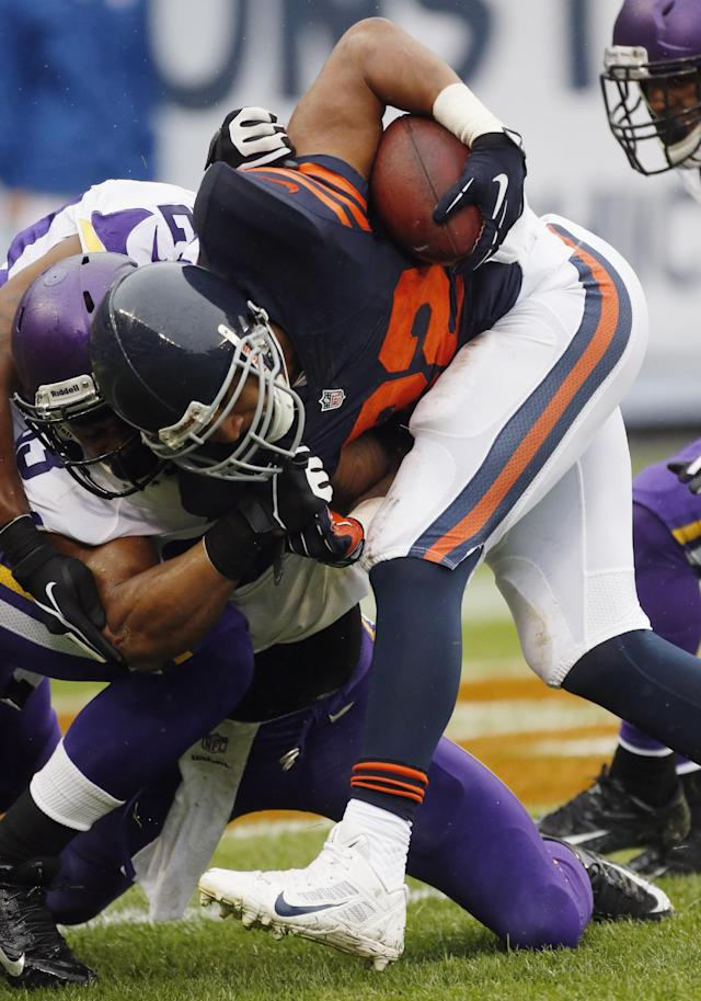 Chicago Bears running back Matt Forte (22) is tackled by Minnesota Vikings safety Jamarca Sanford during the first half of an NFL football game on Sunday, Sept. 15, 2013, in Chicago. (AP Photo/Charles Rex Arbogast)