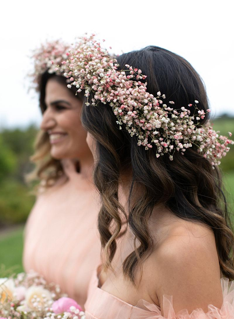 My baby's breath bridesmaids Nicky Ahmadi and Julie Suhk in wearable bouquets by Kiana.