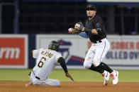 Pittsburgh Pirates' Anthony Alford (6) is forced out at second base as Miami Marlins shortstop Miguel Rojas looks to first, where Michael Perez was safe during the seventh inning of a baseball game Saturday, Sept. 18, 2021, in Miami. (AP Photo/Marta Lavandier)
