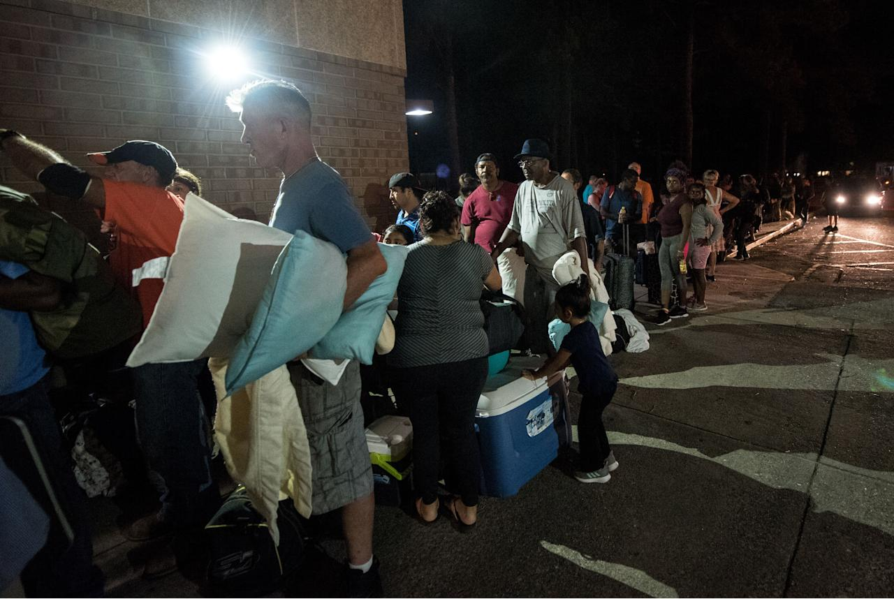 <p>People evacuate ahead of the forecasted landfall of Hurricane Florence as they seek shelter at Emma B. Trask Middle School in Wilmington, N.C., Sept. 11, 2018. (Photo: Caitlin Penna/EPA-EFE/REX/Shutterstock) </p>