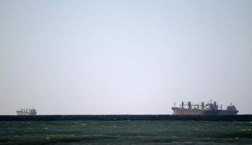 Oil tankers cruise along the Strait of Hormuz off the shores of Tibat in Oman. Iran will close the strategic Strait of Hormuz at the entrance to the oil-rich Gulf only if its crude revenues are seriously threatened, its top military commander said in remarks reported on Saturday