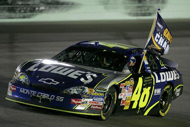 Jimmie Johnson, driver of the #48 Lowe's Chevrolet, celebrates clinching the NASCAR Nextel Cup Series Championship following the Ford 400 at Homestead-Miami Speedway on November 18, 2007 in Homestead, Florida. (Photo by Todd Warshaw/Getty Images for NASCAR)