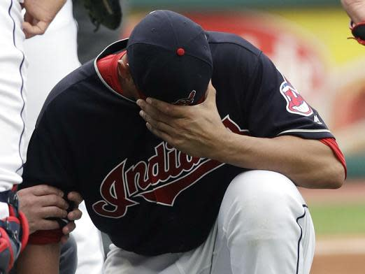 Indians pitcher Carlos Carrasco was hit by a line drive comebacker for the third time in four seasons. (AP)