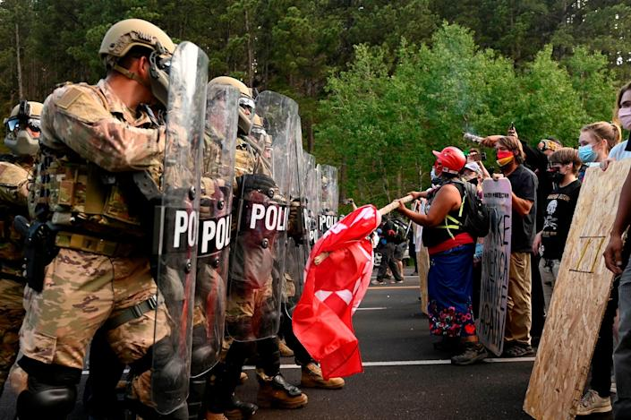 Protesters face off with the South Dakota National Guard near Mount Rushmore on Friday July 3, 2020.