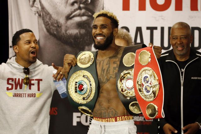 Super welterweight champion Jarrett Hurd shows off his championship belts during a weigh-in, Friday, May 10, 2019, in Arlington, Va., in advance of a boxing match against top contender Julian Williams. The pair are scheduled to square off on Saturday in Fairfax, Va. (AP Photo/Patrick Semansky)