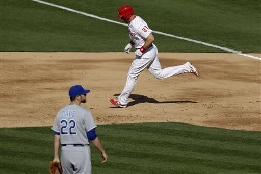 Philadelphia Phillies' Erik Kratz (31) rounds the bases after hitting a home run off Kansas City Royals starting pitcher Wade Davis (22) in the second inning of the Phillies' home-opener baseball game, Friday, April 5, 2013, in Philadelphia. (AP Photo/Matt Rourke)