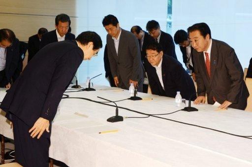 Japanese Prime Minister Yoshihiko Noda (R) greets Fukui Governor Issei Nishikawa (L) at his official residence in Tokyo on June 16. Noda ordered nuclear reactors back online on Saturday, defying public sentiment against atomic power following the quake-tsunami that sparked last year's meltdowns at Fukushima