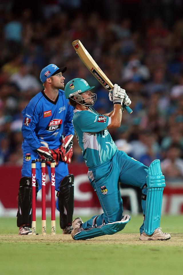 ADELAIDE, AUSTRALIA - DECEMBER 13: Joe Burns of the Heat hits a six during the Big Bash League match between the Adelaide Strikers and the Brisbane Heat at Adelaide Oval on December 13, 2012 in Adelaide, Australia.  (Photo by Morne de Klerk/Getty Images)