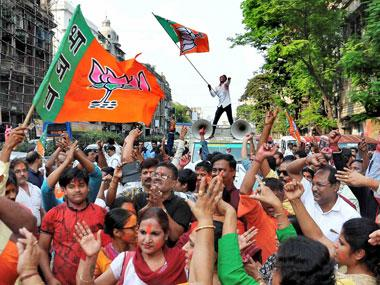 BJP workers shout victory slogans during 'Vijay' rally to celebrate their party's success in North East Assembly elections, outside state party headquarter in Kolkata on Sunday. PTI