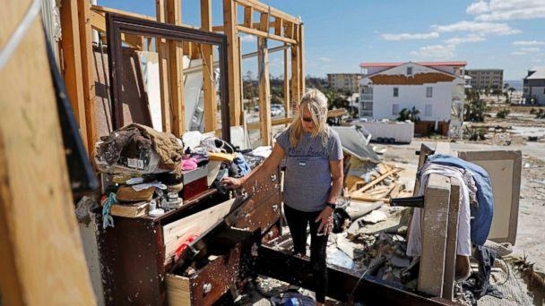 PHOTO: Candace Phillips sifts through what was her third-floor bedroom while returning to her damaged home in Mexico Beach, Fla., Oct. 14, 2018, in the aftermath of Hurricane Michael. (David Goldman/AP)
