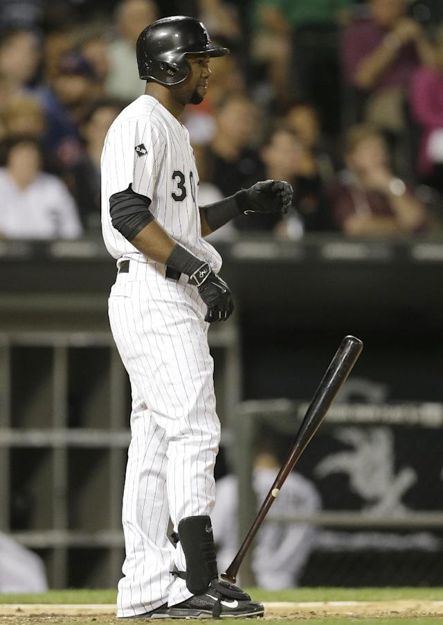 Chicago White Sox's Alejandro De Aza drops his bat after striking out during the sixth inning of a baseball game against the Cleveland Indians in Chicago, Wednesday, Aug. 27, 2014. (AP Photo/Nam Y. Huh)