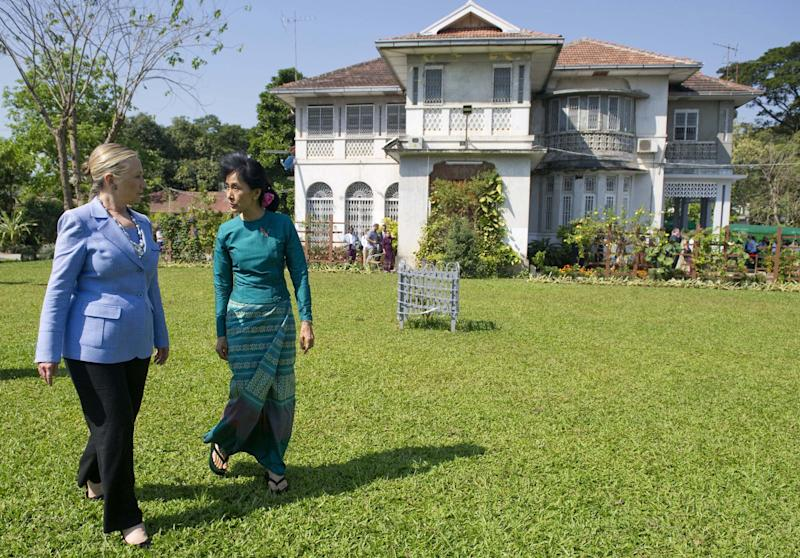 FILE - In this Dec. 2, 2011 file photo, Myanmar's opposition leader Aung San Suu Kyi, right, and U.S. Secretary of State Hillary Rodham Clinton walk through the garden after meetings at Suu Kyi's residence in Yangon, Myanmar. Suu Kyi will appeal a court ruling in favor of her estranged American brother's claim to half-ownership of the two-story lakeside villa she has lived in for almost a quarter century, her lawyer said Monday, June 25, 2012. (AP Photo/Saul Loeb, Pool, File)
