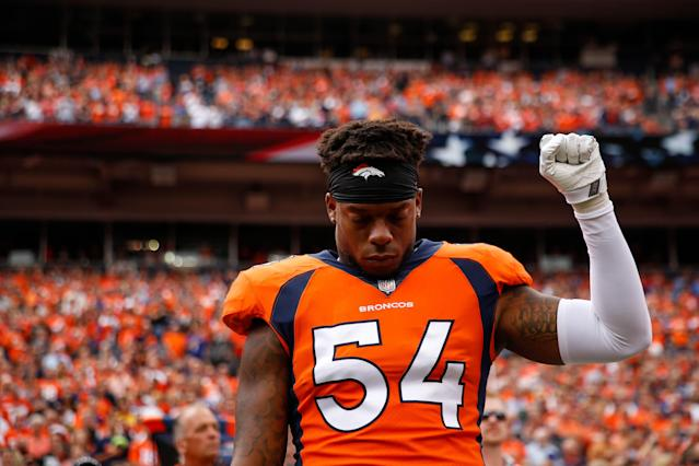 <p>Inside linebacker Brandon Marshall #54 of the Denver Broncos stands and holds a fist in the air during the national anthem before a game against the Oakland Raiders at Sports Authority Field at Mile High on October 1, 2017 in Denver, Colorado. (Photo by Justin Edmonds/Getty Images) </p>