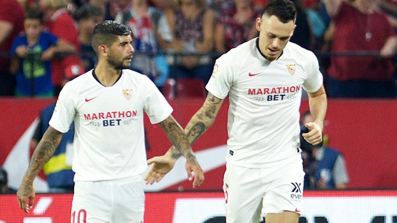 Ever Banega and Lucas Ocampos, pictured here in action for Sevilla in 2019.