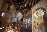 Murals by artists Duncan Grant and Vanessa Bell are seen inside St Michael and All Angels Church in the village of Berwick near Lewes