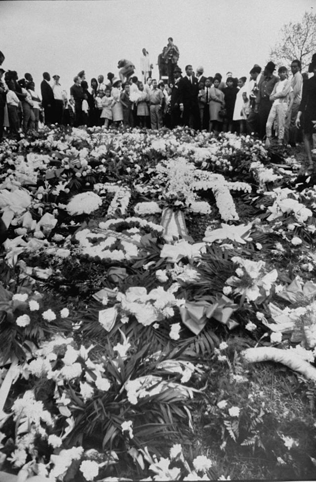 <p>Flowers cover the grave of assassinated civil rights leader Martin Luther King Jr. in Atlanta. (Photo: Vernon Merritt III/Time & Life Pictures/Getty Images) </p>