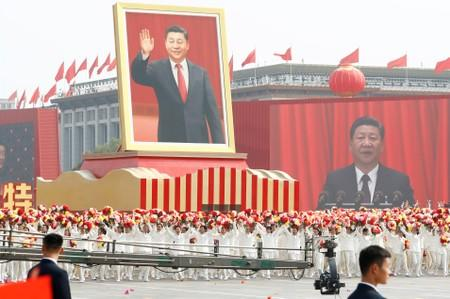 Performers travel past Tiananmen Square with a float showing Chinese President Xi during the parade marking the 70th founding anniversary of People's Republic of China